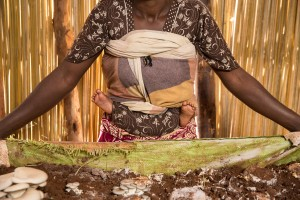 FXB beneficiary in her mushroom growing room, outside Kigali