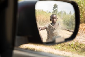 A young boy chases the car as we leave Kabashara, the mountain village overlooking Lake Kivu, Goma and Gisenyi