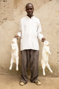 John Dushmimana,with his albino rabbits, Nyanza district Rwanda