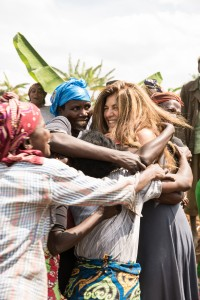 Mob hug after dancing with the women in the banana plantation with FXB Cooperative, Huye district, Rwanda