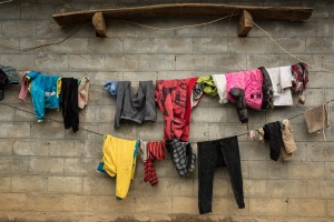Newly washed clothes covered in flies, Bu Tuo County, China