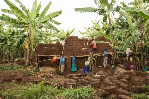 Rwamagana, Rwanda, a group of FXB beneficiaries help one another construct a new home.